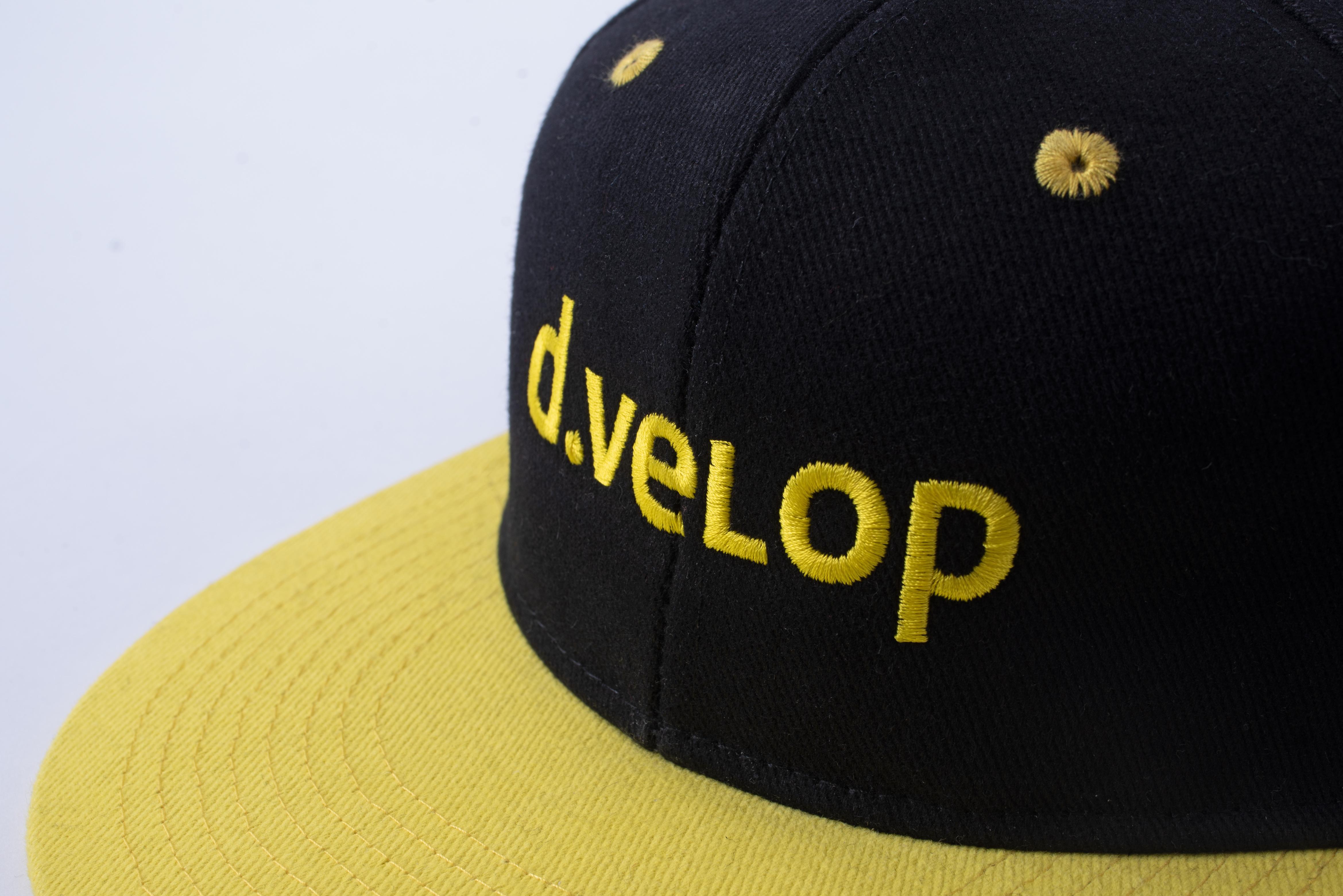 d.velop Cap schwarz gelb